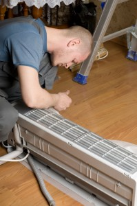 master prepares a new air conditioner to be installed
